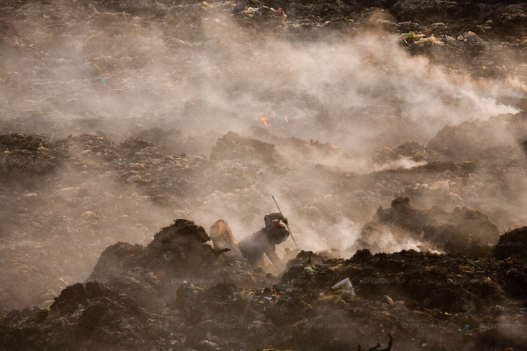 Recycling workers collecting plastic bags on Smokey Mountain rubbish dump.